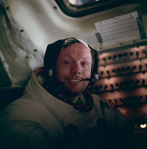 Picture of a smiling Neil Armstrong in the lunar module Eagle