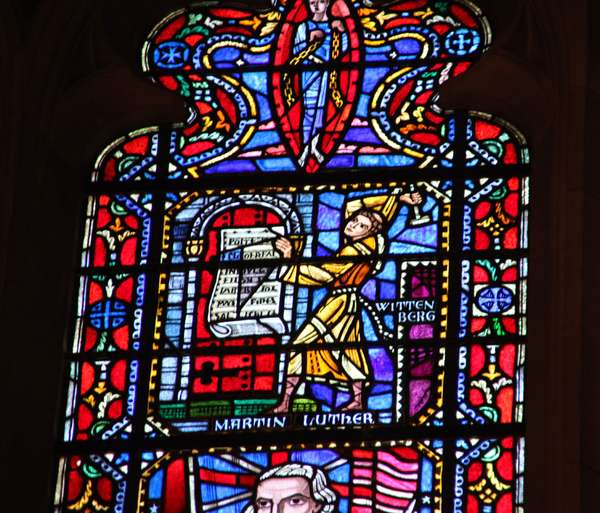 Detail of a church window. Martin Luther nails his 95 theses to the church door in Wittenberg.