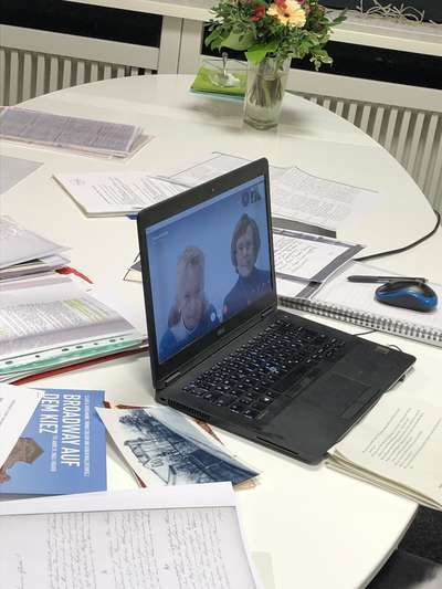 Laptop with open Skype window on the conference table of Beyond History