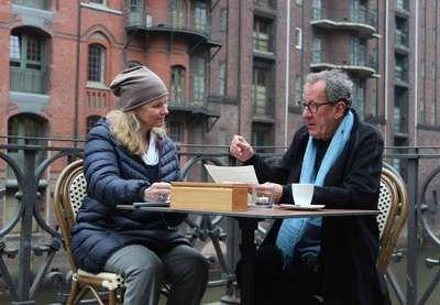 "Andrea Bentscheider and Geoffrey Rush during the filming of ""Who Do You Think You Are?"" in the Speicherstadt Hamburg"